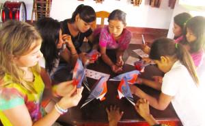 Making origami pigeons at Las Yahoskas