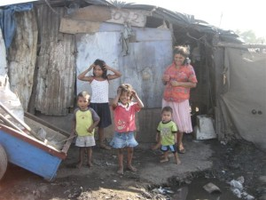 delapidated shack with family in front