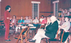 1990s ProNIca planning meeting at the St. Petersburg, Florida Friends Meetinghouse. ProNica founder Jim Carlson seated in front. Long-time ProNica clerk, Ruth Hyde Paine standing.