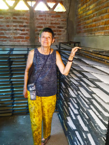 Me by the drying racks at the women's papermaking cooperative