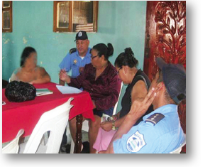 Staff members accompany a domestic violence survivor (whose image has been blurred to conceal her identity). They often bring women to the police for reporting, to the forensic clinic to be evaluated in instances of sexual abuse, and to meetings with lawyers and social workers, as appropriate. Long term empowerment includes support groups, workshops, and assistance with housing as well as income-generating projects.